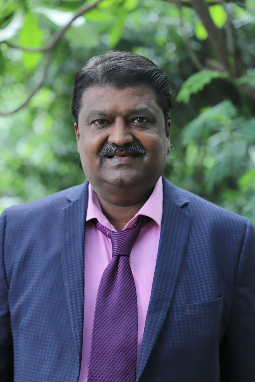 Dr. Manik Kadam
